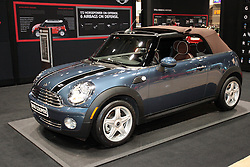 11 February 2009:  2009 MINI CONVERTIBLE: Fun in the sun is at the heart of the '09 MINI Convertible, which includes a fully automatic top with standard heated glass rear window. The innovative ragtop features an integrated power sliding sunroof feature, which allows for open-air motoring and can be opened or closed while traveling at speeds up to 20 mph. From completely closed to fully open, the convertible top operation takes only 15 seconds. When down, much of the folded roof recesses below the rear deck, resulting in a very clean look and eliminating the need for a tonneau cover. Body stiffness has been improved over the former model, with a reduction in vehicle weight by 22 lb. A chain-driven, 1.6-liter four-cylinder engine, with 118 horsepower, is mounted transversely for more cabin space. Mated to the engine is either a six-speed manual or six-speed automatic. The powertrain setup enables the MINI to sprint from 0 to 60 mph in 8.9 seconds. There is 21.4 cubic feet of cargo room with rear seatbacks down, or the interior can hold up to four adults in comfort.The Chicago Auto Show is a charity event of the Chicago Automobile Trade Association (CATA) and is held annually at McCormick Place in Chicago Illinois.