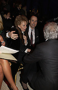 Lily Safra, David Furnish and Giancarlo Giacometti , Valentino couture show, Ecole Nationale Superiore des Beaux -Arts, rue Bonaparte. After party at the Ritz. 23 January  2006.  ONE TIME USE ONLY - DO NOT ARCHIVE  © Copyright Photograph by Dafydd Jones 66 Stockwell Park Rd. London SW9 0DA Tel 020 7733 0108 www.dafjones.com
