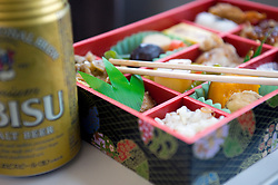 Detail of Bento lunch box containing sushi and traditional snacks in Japan