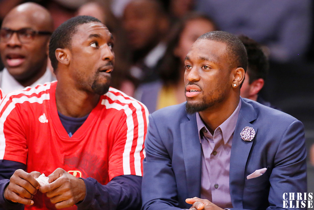 31 January 2014: Charlotte Bobcats point guard Kemba Walker (15) is seen on the bench next to Charlotte Bobcats shooting guard Ben Gordon (8) during the Charlotte Bobcats 110-100 victory over the Los Angeles Lakers at the Staples Center, Los Angeles, California, USA.
