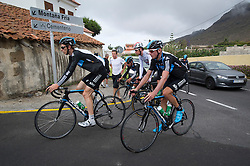 F.A.O Lisa McCLean Daily Telegraph picture desk. ©Ben Cawthra. 19/05/2012. Tenerife, Spain. Three time Olympic gold medalist, cyclist Bradley Wiggins (centre of group white top) with the Sky Pro Cycling team training on the roads surrounding the volcanic island of Tenerife in Spain with coaching team following behind. Pictured riding through the town of Charco Del Pino. Photo credit: Ben Cawthra