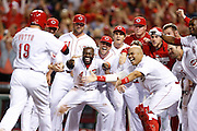 CINCINNATI, OH - MAY 9: Cincinnati Reds players celebrate after Joey Votto's game-winning home run in the bottom of the ninth inning of the game against the Colorado Rockies at Great American Ball Park on May 9, 2014 in Cincinnati, Ohio. The Reds won 4-3. (Photo by Joe Robbins) *** Local Caption *** Joey Votto