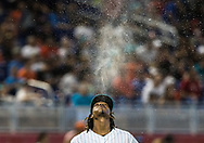 Miami Marlins starting pitcher Jose Ureña spits water prior taking the mount during the first inning of an MLB game against the San Diego Padres at Marlins Park in Miami, Sunday, June 10, 2018.