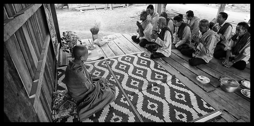 Former Khmer Rouge soldiers and others gather for a merit making ceremony at a poor pagoda near Pailin.  Religion under the Khmer Rouge was forbidden.