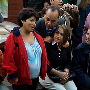 Congressman Luis Gutierrez (D,IL) listens to Jessi Cahuana Castro, who is 8 months pregnant with her 2nd child, speak during CARE's Learning Tour visit to the San Cosme Health Center. San Cosme is a slum in Lima that has the highest rate of tuberculosis in Lima, but has limited health services for the community. The Global Fund is supporting services in San Cosme's health center.