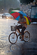 Cycling in the rain, Bangkok.