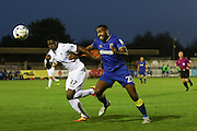 Swansea City U23 defender Tyler Reid (47) and AFC Wimbledon striker Tyrone Barnett (23) during the EFL Trophy match between AFC Wimbledon and U23 Swansea City at the Cherry Red Records Stadium, Kingston, England on 30 August 2016. Photo by Stuart Butcher.