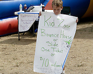 Nathan Smith, 7 of Springboro carries a sign advertising the features of the Kids Zone during Taste of Miami Valley and Home Show in downtown Dayton, Saturday, September 18, 2010.