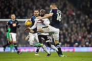 Derby County defender Alex Pearce (16) battles for possesion with Fulham striker Sone Aluko (24) during the EFL Sky Bet Championship match between Fulham and Derby County at Craven Cottage, London, England on 17 December 2016. Photo by Matthew Redman.