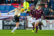Bruce Anderson (#25) of Aberdeen FC clears the ball ahead of Aaron Hickey (#51) of Heart of Midlothian FC during the Ladbrokes Scottish Premiership match between Heart of Midlothian FC and Aberdeen FC at Tynecastle Stadium, Edinburgh, Scotland on 29 December 2019.