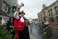 Mark Elphick, Dorking Town Crier, cheers the cyclists through Dorking in The Prudential RideLondon Classic. Sunday 29th July 2018<br /> <br /> Photo: Jon Buckle for Prudential RideLondon<br /> <br /> Prudential RideLondon is the world's greatest festival of cycling, involving 100,000+ cyclists - from Olympic champions to a free family fun ride - riding in events over closed roads in London and Surrey over the weekend of 28th and 29th July 2018<br /> <br /> See www.PrudentialRideLondon.co.uk for more.<br /> <br /> For further information: media@londonmarathonevents.co.uk