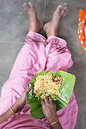 Eating tamarind rice on a banana leaf, Kariakudi, Tamil Nadu, India