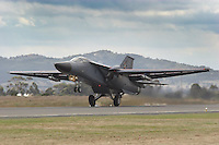 "An RAAF General Dynamics F-111 ""Aardvark"" lands at Avalon Airport following an aerial display at the Airshow"