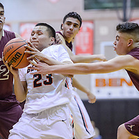 Gallup Bengal Shawn Skeets (23) crashes through the Belen Eagles defense Saturday at Gallup High School.