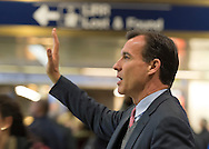 Manhattan, New York, U.S. 4th November 2013. TOM SUOZZI, Democratic candidate for Nassau County Executive, waves to potential voters during his campaign stop at Penn Station, near end of 36 straight hours of barnstorming across Nassau County, leading up to the November 5 general election. Former Nassau County Executive Suozzi and incumbent Republican Mangano are once again facing each other as challengers.