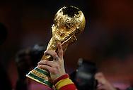Spain's footballer Sergio Ramos holds the trophy during the celebration after winning the 2010 World Cup South Africa football after defeating by 1-0 to Netherlands in the final match, at Soccer City stadium, in Johannesburgo, South Africa, on July 11, 2010.   (Alejandro Pagni/PHOTOXPHOTO).