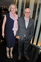 Film director DON BOYD and HILARY BOYD at W London - Leicester Square for the Liberatum Cultural Honour in Spice Market for John Hurt, CBE in association with artist Svetlana K-Lié on 10th April 2013.