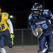 Keevin Thompson rushes against Cape Fear's Damorris Mcdonald Friday November 21, 2014 at Hoggard High School in Wilmington, N.C. (Jason A. Frizzelle)