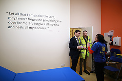 © Licensed to London News Pictures. 02/12/2016. Manchester, UK. Greater Manchester Mayoralty candidate ANDY BURNHAM MP visits the Barnabus homeless centre on Bloom Street in Manchester and is shown a healthcare and treatment room within the facility . Barnabus provides food and support for people who sleep rough . In the last week , two people in Manchester and one in Birmingham have died whilst sleeping rough . Photo credit: Joel Goodman/LNP