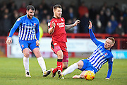 Hartlepool United midfielder Michael Woods (14) gets to the ball ahead of Crawley Town forward James Collins (19) during the EFL Sky Bet League 2 match between Crawley Town and Hartlepool United at the Checkatrade.com Stadium, Crawley, England on 14 January 2017. Photo by David Charbit.