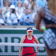 PARIS, FRANCE June 01. Winner Sofia Kenin of the United States heads to meet Serena Williams of the United States at the net during the Women's Singles third round match on Court Philippe-Chatrier at the 2019 French Open Tennis Tournament at Roland Garros on June 1st 2019 in Paris, France. (Photo by Tim Clayton/Corbis via Getty Images)