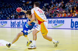 Sebastian Skube of Slovenia vs Velko Markoski of FYR Macedonia during handball match between Slovenia and F.Y.R. Macedonia for 5th place at 10th EHF European Handball Championship Serbia 2012, on January 27, 2012 in Beogradska Arena, Belgrade, Serbia.  (Photo By Vid Ponikvar / Sportida.com)