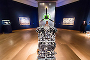 Spitfire Engine and Propeller with curator Alina Brezhneva - Christie's Curates: PAST PERFECT / FUTURE PRESENT. A celebration of creativity which launches the summer season, this exhibition showcases a dynamic 'juxtaposition' of art from across the ages alongside innovative and new media works by four emerging artists: James Balmforth, Armand Boua, Olga Chernysheva and Harry Sanderson. This year's curators Alina Brezhneva, Bianca Chu, Milo Dickinson and Tancredi Massimo di Roccasecca 'drive the exhibition in to a bold new chapter'. Highlights: the black felt bicorne hat, once belonging to the Emperor Napoleon and worn by him during the whole Campaign of 1807, in the Battle of Eylau and Friedland, and at the Treaty of Tilsit; the Merlin III engine from an authentic and immaculately restored Vickers Supermarine Spitfire Mk.1A – P9374/G-MK1A. This is a truly iconic aircraft which is symbol of the bravery 'of the few' in the Battle of Britain; and the first opportunity to view Chris Ofili's The Holy Virgin Mary (1996) in London - first exhibited at the generation-defining exhibition 'Sensation' in London and New York, The Holy Virgin Mary was a focal point for the widespread attention the exhibition received throughout the international media landscape, and dates from a moment that saw Ofili propelled to international fame. The works will be on view to the public from 12-16 June at Christie's King Street,