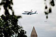 WASHINGTON, DC - APRIL 17:  The Space Shuttle Columbia makes a pass over Washington, DC atop a NASA Boeing 747 on April 17, 2012 on its final trip to Dulles International Airport in Virginia. The shuttle will be installed as a museum piece at the Smithsonian Institution's air and space facility in Chantilly Virginia.  (Photo by Pete Marovich/Getty Images)