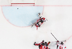 Fabrice Herzog of Switzerland scoring third  - winning goal for Switzerland against Calvin Pickard of Canada during the 2017 IIHF Men's World Championship group B Ice hockey match between National Teams of Canada and Switzerland, on May 13, 2017 in AccorHotels Arena in Paris, France. Photo by Vid Ponikvar / Sportida