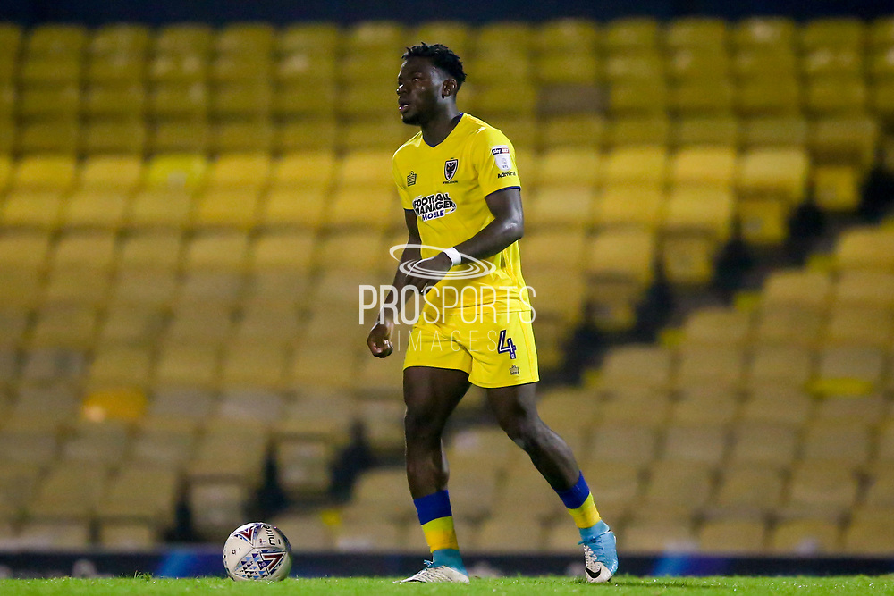 AFC Wimbledon defender Adedeji Oshilaja (4) looks for a pass during the EFL Sky Bet League 1 match between Southend United and AFC Wimbledon at Roots Hall, Southend, England on 26 September 2017. Photo by Simon Davies.