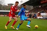 Crawley Town defender Josh Yorwerth (15) puts pressure on Grimsby Town forward Mallik Wilks (18) during the EFL Sky Bet League 2 match between Crawley Town and Grimsby Town FC at the Checkatrade.com Stadium, Crawley, England on 10 February 2018. Picture by Andy Walter.