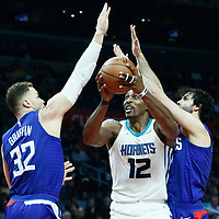 31 December 2017: Charlotte Hornets center Dwight Howard (12) drives past LA Clippers guard Milos Teodosic (4) and LA Clippers forward Blake Griffin (32) during the LA Clippers 106-98 victory over the Charlotte Hornets, at the Staples Center, Los Angeles, California, USA.