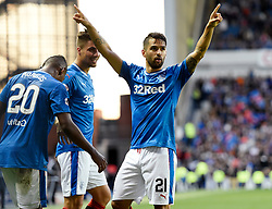 Rangers' Daniel Candeias celebrates with Alfredo Morelos and Fabio Cardoso after scoring the fifth goal during the Betfred Cup, Second Round match at Ibrox Stadium, Glasgow.