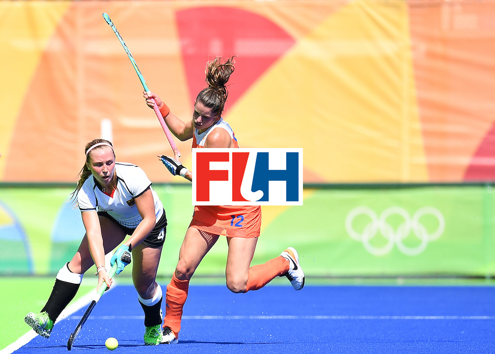 Germany's Nike Lorenz (L) and Netherlands' Lidewij Welten vie during the women's field hockey Netherlands vs Germany match of the Rio 2016 Olympics Games at the Olympic Hockey Centre in Rio de Janeiro on August, 13 2016. / AFP / MANAN VATSYAYANA        (Photo credit should read MANAN VATSYAYANA/AFP/Getty Images)