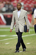 Houston Texans general manager Rick Smith walks off the field after pre game warmups at the 2014 NFL preseason football game against the Arizona Cardinals on Saturday, Aug. 9, 2014 in Glendale, Ariz. The Cardinals won the game in a 32-0 shutout. ©Paul Anthony Spinelli