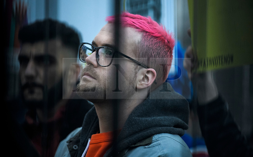 © Licensed to London News Pictures. 29/03/2018. London, UK. Whittleblowers SHAHMIR SANNI and CHRISTOPHER WYLIE wait to speak at a demonstration held by Fair Vote, outside the Houses of Parliament in London, calling for a fair vote on the EU referendum. Whistleblowers Shahmir Sanni and Christopher Wylie both spoke at the event attended by a small number of people.. Photo credit: Ben Cawthra/LNP