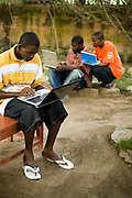 Students use laptops to browse the internet over a wireless network at the Kokrobitey Institute in the town of Kokrobitey, 30km west of Ghana's capital Accra on Sunday January 18, 2009. From left to right Joshua Sarbah, Oti Dodoo, Abass Aryee.