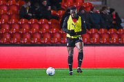 Dimitri Cavare of Barnsley (12) warming up during the EFL Sky Bet League 1 match between Doncaster Rovers and Barnsley at the Keepmoat Stadium, Doncaster, England on 15 March 2019.