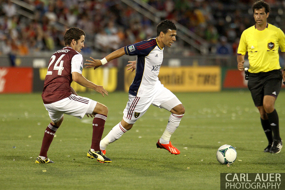 August 3rd, 2013 - Real Salt Lake midfielder Javier Morales (11) pushes the ball past Colorado Rapids midfielder Nathan Sturgis (24) in the first half of action in the Major League Soccer match between Real Salt Lake and the Colorado Rapids at Dick's Sporting Goods Park in Commerce City, CO