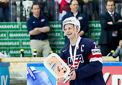 Matt Hendricks of USA with a trophy after winning during Ice Hockey match between USA and Czech Republic at Third place game of 2015 IIHF World Championship, on May 17, 2015 in O2 Arena, Prague, Czech Republic. Photo by Vid Ponikvar / Sportida