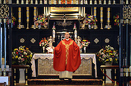 POPESHRINE20P<br /> Father Rafal Walczyk says a prayer at the altar during 11:30am mass at  the National Shrine of Our Lady of Czestochowa Monday September 14, 2015 in Doylestown, Pennsylvania. Pope Francis will visit Philadelphia September 26 and 27th. (William Thomas Cain/For The Inquirer)