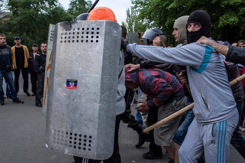 DONETSK, UKRAINE - MAY 4: Pro-Russian protesters detain a man who was beaten and accused of being a provocateur outside the Executive Council building on May 4, 2014 in Donetsk, Ukraine. Cities across Eastern Ukraine have been overtaken by pro-Russian protesters in recent weeks, leading the Ukrainian military to respond with force in some areas. (Photo by Brendan Hoffman for The Washington Post)