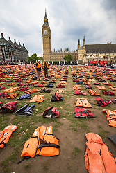Parliament Square, London, September 19th 2016. 2,500 lifejackets make up a lifejacket graveyard in London's Parliament Square to highlight the plight of refugees as world leaders meet in New York for the United Nations Migration Summit. The lifejackets are those actually worn by refugees during treacherous sea crossings from Africa and Turkey into Europe. &copy;Paul Davey<br /> FOR LICENCING CONTACT: Paul Davey +44 (0) 7966 016 296 paul@pauldaveycreative.co.uk