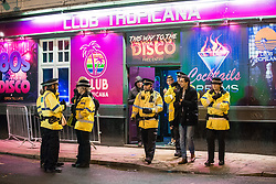 """© Licensed to London News Pictures . 15/12/2017. Manchester, UK. Several police officers respond to an incident at Club Tropicana in the city's Gay Village . Revellers out in Manchester City Centre overnight during """" Mad Friday """" , named for historically being one of the busiest nights of the year for the emergency services in the UK . Photo credit: Joel Goodman/LNP"""