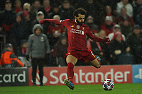 Football - 2019 / 2020 UEFA Champions League - Round of Sixteen, Second Leg: Liverpool (0) vs. Atletico Madrid (1)<br /> <br /> Liverpool's Mohamed Salah shoots at goal, at Anfield.<br /> <br /> <br /> COLORSPORT/TERRY DONNELLY