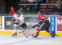 KELOWNA, CANADA - OCTOBER 4:  Jesse Lees #2 of the Kelowna Rockets steals the puck from Presten Kopeck #12 of the Portland Winterhawks at the Kelowna Rockets on October 4, 2013 at Prospera Place in Kelowna, British Columbia, Canada (Photo by Marissa Baecker/Shoot the Breeze) *** Local Caption ***