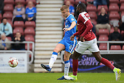 Gillingham FC midfielder Jake Hessenthaler (8) looks to release the ball during the EFL Sky Bet League 1 match between Northampton Town and Gillingham at Sixfields Stadium, Northampton, England on 30 April 2017. Photo by Dennis Goodwin.