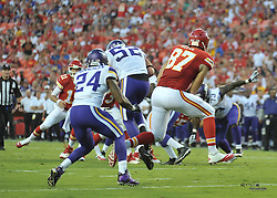 Aug 23, 2014; Kansas City, MO, USA; Minnesota Vikings outside linebacker Chad Greenway (52) intercepts a pass intended for Kansas City Chiefs tight end Travis Kelce (87) in the first half at Arrowhead Stadium. Mandatory Credit: Denny Medley-USA TODAY Sports