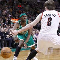 09 March 2012: Boston Celtics point guard Keyon Dooling (51) passes the ball past Portland Trail Blazers small forward Luke Babbitt (8) during the Boston Celtics 104-86 victory over the Portland Trail Blazers at the TD Banknorth Garden, Boston, Massachusetts, USA.