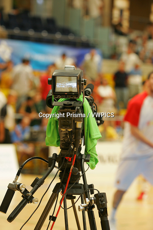 TV camera at a Basketball game. Spain and Algeria at the XV Mediterranean Games Almeria 2005 in Almeria. Spain.... B1270